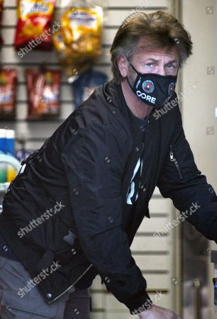 Stock Picture of Sean Penn shopping in Brentwood
