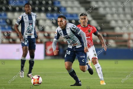 Stock Image of Luis Chavez (L) OF Pachuca in action  against Dario Lezcano (R) of FC Juarez during the Liga MX Clausura Tournament soccer match between Pachuca and FC Juarez, at the Hidalgo Stadium in Pachuca, Mexico, 11 January 2021.