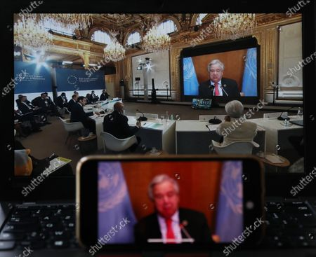 Stock Image of Photo taken in Paris, France, on Jan. 11, 2021 shows screens displaying UN Secretary-General Antonio Guterres addressing the One Planet Summit for biodiversity. World leaders on Monday reiterated the urgent need for concerted global action to safeguard biodiversity and for a global governance framework on climate issues in the post-pandemic era. Organized by the French government in partnership with the UN and the World Bank, the One Planet Summit brought together world leaders to commit action to protect and restore biodiversity.