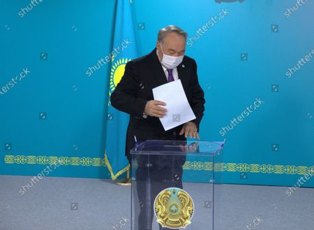 Kazakhstan's First President Nursultan Nazarbayev casts his ballot to vote deputies of the Assembly of People of Kazakhstan  in the parliament in Nur-Sultan, Kazakhstan, Jan. 11, 2021. Nine deputies of the Assembly of People of Kazakhstan, an advisory body representing the country's major ethnic groups, were elected Monday to become lawmakers in the Majilis, the lower house of the Kazakh parliament, local media reported.