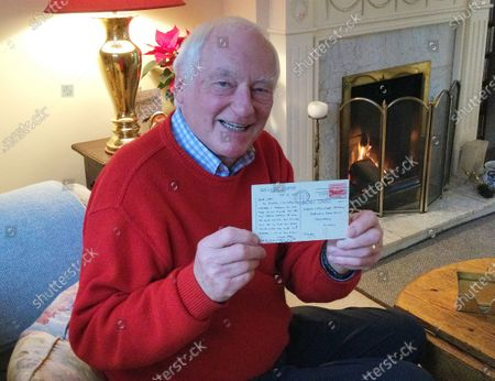Stock Photo of Chris with the long 'lost' postcard.   A 'lost' postcard from 1955 has finally been delivered to its recipient 66 years later.  Chris Hermon, 75, was sent it from an American pen pal when he was a young boy living in Sussex but it never reached its destination.  However, the correspondence was recently discovered at a charity shop in Dorchester, Dorset.