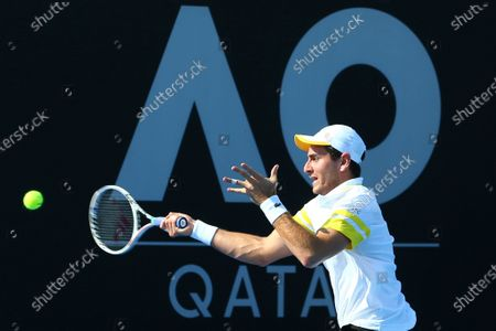 Stock Image of Elliot Benchetrit of Morroco plays against Denis Kudla of the United States at their round 1 match at the Australian Open 2021 Men's Qualifying in Doha, Qatar, on Jan. 11, 2021. U.S. tennis player Denis Kudla tested positive for COVID-19 at the Australian Open qualifiers in Doha on Monday, with officials interrupting his match to deliver the result.