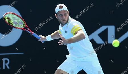 Denis Kudla of the United States plays against Elliot Benchetrit of Morroco at their round 1 match at the Australian Open 2021 Men's Qualifying in Doha, Qatar, on Jan. 11, 2021. U.S. tennis player Denis Kudla tested positive for COVID-19 at the Australian Open qualifiers in Doha on Monday, with officials interrupting his match to deliver the result.