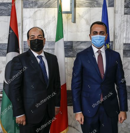 Stock Photo of Italian Foreign Affairs Minister Luigi Di Maio (R) poses with Libya's UN-backed Government of National Accord (GNA) Deputy Prime Minister and Vice Chairman of the Presidential Council of Libya Ahmed Maiteeq (L), during a bilateral meeting in Rome, Italy, 12 Jannuary 2021.