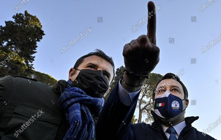 The leader of Lega Matteo Salvini (R) and colleague Gian Marco Centinaio (L) meet protesters during a demonstration by tourist agencies, operators and guides at Piazza del Popolo in Rome, Italy, 12 January 2021.