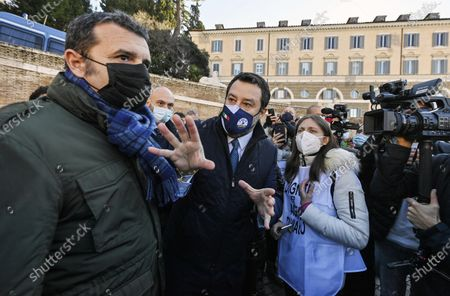 The leader of Lega Matteo Salvini (C) and his colleague Gian Marco Centinaio (L) meet protesters during a demonstration by tourist agencies, operators and guides at Piazza del Popolo in Rome, Italy, 12 January 2021.