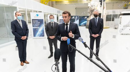 A guest, French Overseas Minister Sebastien Lecornu, French President Emmanuel Macron and French Economy Minister Bruno Le Maire.