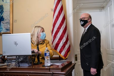 Stock Image of House Rules Committee Chairman Jim McGovern, D-Mass., right, joined at left by Rep. Debbie Lesko, R-Ariz., welcomes panel members as he leads a virtual hearing to consider a resolution calling on Vice President Mike Pence to activate the 25th Amendment to declare President Donald Trump incapable of executing the duties of his office, at the Capitol in Washington