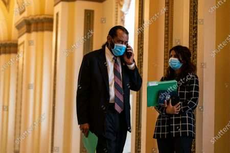 U.S. Representative Al Green (D-TX) takes a phone call on Capitol Hill, nearly a week after a pro-Trump insurrectionist mob breached the security of the nation's capitol while Congress voted to certify the 2020 Election Results on Monday, Jan. 11, 2021 in Washington, DC. (Kent Nishimura / Los Angeles Times)