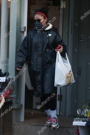 Stock Photo of Alex Scott shopping in Primrose Hill