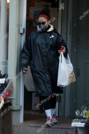 Stock Image of Alex Scott shopping in Primrose Hill