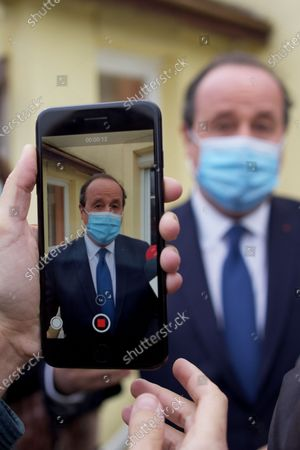 Former French President Francois Hollande speaks to the press about the Coronavirus vaccine in Central France