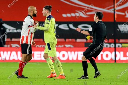 Sheffield United forward David McGoldrick (17) and Newcastle United defender Fabian Schar (5) square up during the Premier League match between Sheffield United and Newcastle United at Bramall Lane, Sheffield