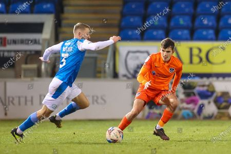 Harry Kavanagh (38) of Portsmouth defends  from Dan Butler (3) of Peterborough United during the EFL Trophy match between Peterborough United and Portsmouth at the Weston Homes Stadium, London Road, Peterborough