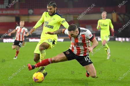 Sheffield United's Billy Sharp challenges for the ball with Newcastle's DeAndre Yedlin during the English Premier League soccer match between Sheffield United and Newcastle United at the Bramall Lane stadium in Sheffield, England