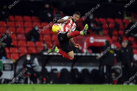 Sheffield United's Rhian Brewster tries to control the ball during the English Premier League soccer match between Sheffield United and Newcastle United at the Bramall Lane stadium in Sheffield, England