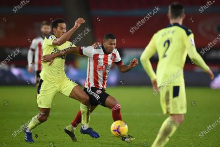 Stock Photo of Sheffield United's Rhian Brewster, right, is fouled by Newcastle's Isaac Hayden during the English Premier League soccer match between Sheffield United and Newcastle United at the Bramall Lane stadium in Sheffield, England