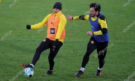 Dortmund's Lukasz Piszczek (L) and Dortmund's Mats Hummels attend the team's training session at the training ground in Dortmund, Germany, 12 January 2021.