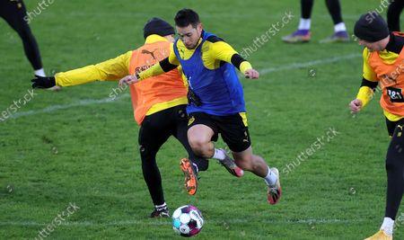 Dortmund's Lukasz Piszczek (L) and Dortmund's Raphael Guerreiro (R) attend the team's training session at the training ground in Dortmund, Germany, 12 January 2021.