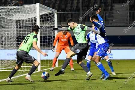 Ryan Longman (29) of AFC Wimbledon battles for possession with Mark Little (2) of Bristol Rovers during the EFL Trophy match between Bristol Rovers and AFC Wimbledon at the Memorial Stadium, Bristol
