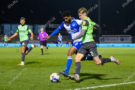 Jack Rudoni (12) of AFC Wimbledon battles for possession with Mark Little (2) of Bristol Rovers during the EFL Trophy match between Bristol Rovers and AFC Wimbledon at the Memorial Stadium, Bristol