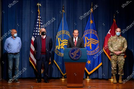 Health and Human Services Secretary Alex Azar, center, speaks during a news conference on Operation Warp Speed and COVID-19 vaccine distribution, in Washington. Standing alongside Azar from left are Dr. Moncef Slaoui, chief science adviser to Operation Warp Speed, Dr. Robert Redfield, director of the Centers for Disease Control and Prevention, and U.S. Army Gen. Gustave Perna, chief operating officer of Operation Warp Speed