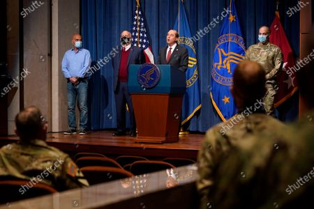Health and Human Services Secretary Alex Azar speaks during a news conference on Operation Warp Speed and COVID-19 vaccine distribution, in Washington. Standing alongside Azar from left are Dr. Moncef Slaoui, chief science adviser to Operation Warp Speed, Dr. Robert Redfield, director of the Centers for Disease Control and Prevention, and U.S. Army Gen. Gustave Perna, chief operating officer of Operation Warp Speed