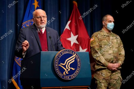 Dr. Robert Redfield, director of the Centers for Disease Control and Prevention, speaks alongside U.S. Army Gen. Gustave Perna, chief operating officer of Operation Warp Speed, during a news conference on Operation Warp Speed and COVID-19 vaccine distribution, in Washington