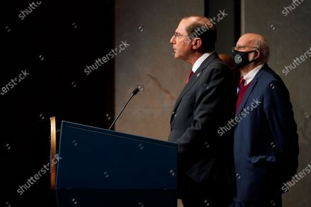 Health and Human Services Secretary Alex Azar speaks alongside Dr. Robert Redfield, director of the Centers for Disease Control and Prevention, during a news conference on Operation Warp Speed and COVID-19 vaccine distribution, in Washington