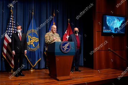 Army Gen. Gustave Perna, chief operating officer of Operation Warp Speed, speaks during a news conference on Operation Warp Speed and COVID-19 vaccine distribution, in Washington. Standing alongside Perna are Health and Human Services Secretary Alex Azar, left, and Dr. Robert Redfield, director of the Centers for Disease Control and Prevention