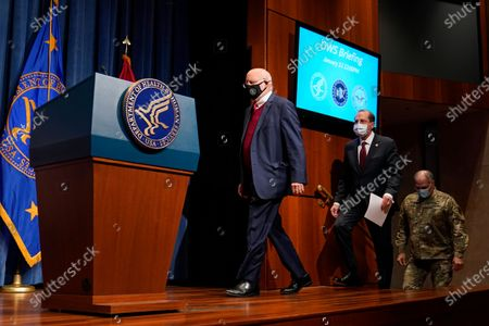 Dr. Robert Redfield, from left, director of the Centers for Disease Control and Prevention, Health and Human Services Secretary Alex Azar and U.S. Army Gen. Gustave Perna, chief operating officer of Operation Warp Speed, walk onstage to speak at a news conference on Operation Warp Speed and COVID-19 vaccine distribution, in Washington