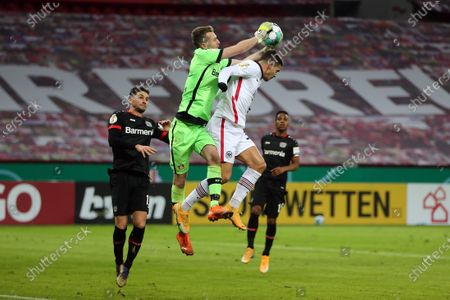 Lukas Hradecky of Bayer Leverkusen catches the ball in front of Andre Silva of Eintracht Frankfurt during the DFB Cup second round match between Bayer 04 Leverkusen and Eintracht Frankfurt at BayArena in Leverkusen, Germany, 12 January 2021.