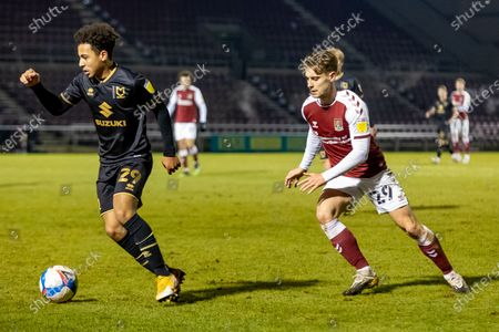Milton Keynes Dons Defender Matthew Sorinola (29) is chased down by Northampton Town Forward Danny Rose (29) during the EFL Trophy match between Northampton Town and Milton Keynes Dons at the PTS Academy Stadium, Northampton