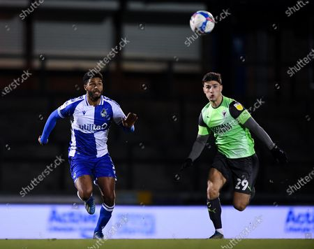 Mark Little of Bristol Rovers chases the loose ball with Ryan Longman of AFC Wimbledon