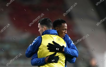 Everton's Michael Keane (L) and Everton's Yerry Mina (R) embrace ahead of the English Premier League soccer match between Wolverhampton Wanderers and Everton FC in Wolverhampton, Britain, 12 January 2021.