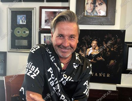 "Venezuelan-Argentine singer Ricardo Montaner poses at his restaurant in Surfside, Fla., during an interview on . Montaner's ""Amen"", an inspirational single with his children Mau, Ricky and Evaluna and his son in law Camilo has amassed more than 100 million views since it's release on Dec. 23"