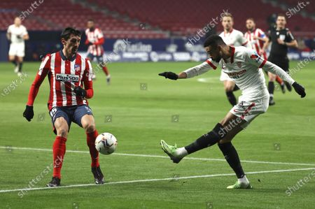 Atletico Madrid's Stefan Savic (L) in action against Sevilla FC's Youssef en Nesyri (R) during a Spanish LaLiga soccer match between Atletico Madrid and Sevilla FC in Madrid, Spain, 12 January 2021.