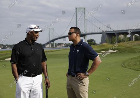 New York Yankee's Alex Rodriguez, right, talks with former baseball player Darryl Strawberry during a fundraiser at the Trump Golf Links at Ferry Point in the Bronx borough of New York. New York City is looking to terminate its contracts with President Donald Trump to run two Central Park skating rinks and other facilities after a Trump-inspired mob rioted and breached the U.S. Capitol last week, Mayor Bill de Blasio said