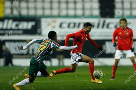 Estrela da Amadora player Ronald Murillo (L) in action against Benfica player Diogo Goncalves during their Portuguese Cup soccer match held at Jose Gomes Stadium in Reboleira, Amadora, Portugal, 12 January 2021.