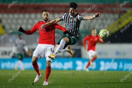 Estrela da Amadora player Paollo Oliveira (R) in action against Benfica player  Haris Seferovic during their Portuguese Cup soccer match held at Jose Gomes Stadium in Reboleira, Amadora, Portugal, 12 January 2021.
