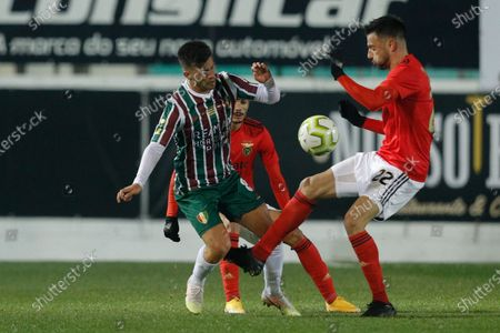 Estrela da Amadora player Paollo Oliveira (L) in action against Benfica player Andreas Samaris during their Portuguese Cup soccer match held at Jose Gomes Stadium in Reboleira, Amadora, Portugal, 12 January 2021.