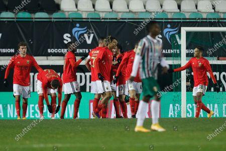 Benfica players celebrate after scoring a goal against Estrela da Amadora during the Portuguese Cup soccer match between Estrela da Amadora and Benfica, held at Jose Gomes Stadium in Reboleira, Amadora, Portugal, 12 January 2021.