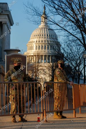 National Guard soldiers stand post near the US Capitol in Washington, DC, USA, 12 January 2021. The House will vote tonight to invoke the 25th amendment forcing Vice President Mike Pence to meet with members of the cabinet about removing US President Donald J. Trump from office for incitement of insurrection following the attack on the US Capitol on 06 January as lawmakers worked to certify Joe Biden as the next President of the United States.