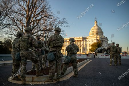 National Guard soldiers stand post at the US Capitol in Washington, DC, USA, 12 January 2021. The House will vote tonight to invoke the 25th amendment forcing Vice President Mike Pence to meet with members of the cabinet about removing US President Donald J. Trump from office for incitement of insurrection following the attack on the US Capitol on 06 January as lawmakers worked to certify Joe Biden as the next President of the United States.