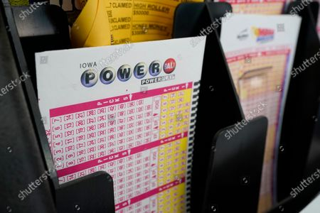 Blank forms for the Powerball lottery sit in a bin at a local grocery store, in Des Moines, Iowa. Lottery players have a chance to win the largest jackpots in nearly two years as Tuesday's Mega Millions has grown to an estimated $625 million and Wednesday's Powerball to an estimated $550 million