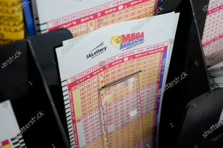 Blank forms for the Mega Millions lottery sit in a bin at a local grocery store, in Des Moines, Iowa. Lottery players have a chance to win the largest jackpots in nearly two years as Tuesday's Mega Millions has grown to an estimated $625 million and Wednesday's Powerball to an estimated $550 million