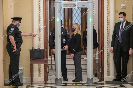 Republican representative from Georgia Marjorie Taylor Greene goes through a new security checkpoint to get on the House floor inside the US Capitol in Washington, DC, USA, 12 January 2021. The House will vote tonight to invoke the 25th amendment forcing Vice President Mike Pence to meet with members of the cabinet about removing US President Donald J. Trump from office for incitement of insurrection following the attack on the US Capitol on 06 January as lawmakers worked to certify Joe Biden as the next President of the United States.