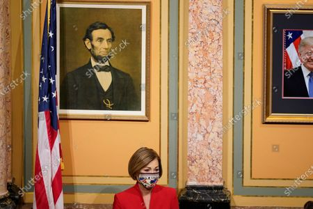 Iowa Gov. Kim Reynolds waits to deliver her Condition of the State address before a joint session of the Iowa Legislature, at the Statehouse in Des Moines, Iowa