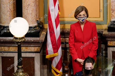 Iowa Gov. Kim Reynolds looks on after delivering her Condition of the State address before a joint session of the Iowa Legislature, at the Statehouse in Des Moines, Iowa