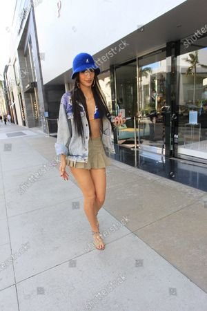 Stock Image of Lexy Panterra seen wearing a jean jacket and a blue brimmed hat